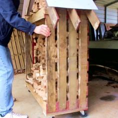 Here is a Simple way I built a wood storage rack from 2 old pallets. It can hold a bunch of wood in preparation for next winter. garden furniture Firewood Storage Rack from 2 Pallets