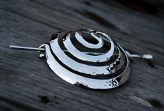 Hammered Silver Spiral Bun Ornament by DreamingDragonDesign.deviantart.com on @deviantART
