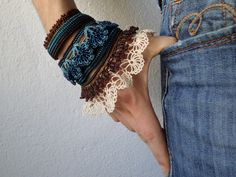 handmade beaded crochet bracelet with laces and beaded flowers in cream, brown, green and blue colors