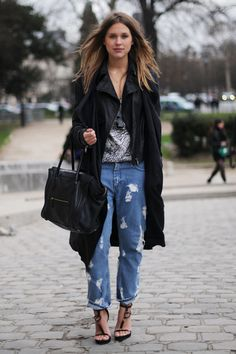 Sabrina Meijer wears a Dior jacket & Céline tote with ripped blue jeans | elle