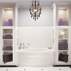 Definitely want a chandelier over the bathtub. Love the lighted storage flanking both sides!