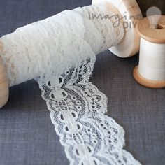 Pretty vintage style lace with decorative border and ribbon effect. DIY wedding supplies