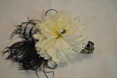 Spider mum wrist corsage with feathers