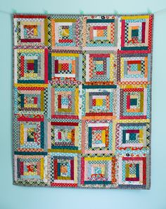 Love this scrap-happy Log Cabin baby quilt! That striped binding really ties it together. From Audrie Bidwell via the Blue is Bleu blog.
