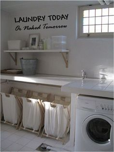 Love the space underneath for laundry hampers. Would label them whites, colors, darks: