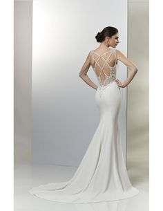 Wow! Just look at this gorgeously detailed back! Available at Spotlight Formal Wear! #SpotlightBridal