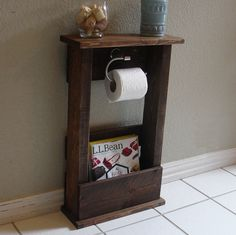 Handcrafted toilet paper holder stand with shelf and storage pocket. The perfect addition to any home bathroom or apartment.  It has been lightly sanded