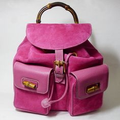 Offered for your consideration is this stylish, Authentic Gucci Vintage Magenta Pink Suede and Leather Backpack. This attractive Gucci backpack is in