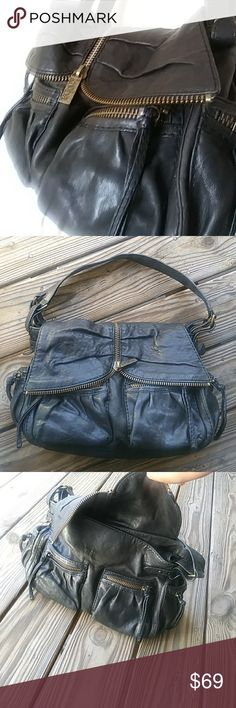 Kooba hand bag This bag is very Beautyful. Made with very soft real leather. The big zippers and ruching on the pockets give this bag its beautiful rustic character. In great condition kooba Bags Shoulder Bags