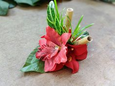 Tiki hawaiian hair flower clip with red tropical flowers, leaves and bamboo! The perfect rockabilly summer hair accessory! Handmade and only one of a kind!