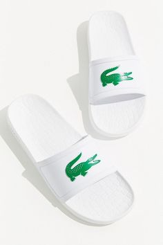 Slide into these sporty slip-on sandals from Lacoste. Rubber sole upper featuring the iconic crocodile logo. Fitted with a cushy, molded foot bed for optimal comfort. Lacoste Shoes Women, Crocodile Logo, White High Heels, Rubber Sandals, Fall Booties, Funky Shoes, Beach Flip Flops, Flip Flop Shoes, Bride Shoes