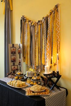 bumble bee theme.  black and yellow.  yellow chevron.  fabric garland.  decor table.  april's baby shower.