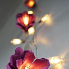 DIY decorations: egg carton and fairy light flowers! For more #weddingdiy visit www.modernwedding.com.au.