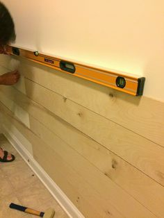 DIY Ship Lap Wall....good idea for laundry room wall opposite washer/dryer....takes dings, etc.