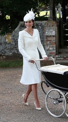 Wearing a classic knee-length cream coat dress by British designer Alexander McQueen, Kate proved she's still a creature of habit in terms of her sartorial tendencies since the appearance evoked the memory of the similar long-sleeved McQueen creation she wore to Prince George's christening.