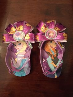 Disney inspired Anna and Elsa Frozen sandals little girls flip flops. Bottle cap ribbon purple summer shoes dress up beach birthday party  by CreationsbySAHM on Etsy https://www.etsy.com/listing/228342476/disney-inspired-anna-and-elsa-frozen