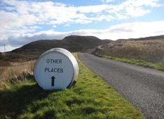 Roadside sign on a whisky barrel, on the road from Bunnahabhain, Isle of Islay, Scotland