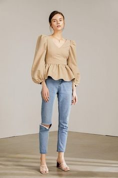 Light tan peplum blouse with v-neck collar, puffed shoulders, long peasant sleeves and flounced bottom half for a feminine and romantic feel. Look Fashion, Hijab Fashion, Korean Fashion, Fashion Dresses, Womens Fashion, Fashion Design, Stylish Tops, Trendy Tops, Looks Chic