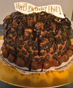 Totally Wasted Chocolate Cake...Valrhona Chocolate Cake filled with homemade Caramel. frosted with Valrhona Buttercream and topped with Calabaut Chocolate Chips, chopped Candy Bars, Chocolate Ganache and Caramel Drizzle