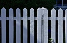 White picket fence, shadows two; Chestnut Hill Street Fair; Philadelphia, Pennsylvania, USA. October 2014.