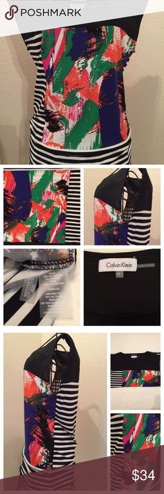 Calvin Klein bold look blouse! Size medium, EUC Catch everyone's eye with this black & white striped blouse with block of colorful splashes. Pair it with so many options you probably already have in your closet! Calvin Klein Tops Blouses