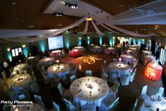 8 point ceiling swag. Pin spots on every table. Teal uplights around the room and a single letter monogram on the dance floor  Photo Credit- Kim Greer  #CincinnatiWedding #PartyPleasers #CeilingSwag #Uplights #Singlelettermonogram #Pinspotlighting