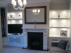 Fretwork doors (for entertainment remote infra red) with floating shelves and integrated lighting.