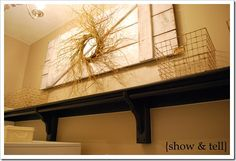 I love this idea for a big wall that needs something to fill it.