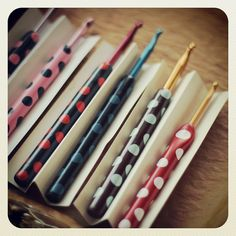 polymer clay crochet hook handles.  Interesting idea...I could make mine all longer, since they're all too short for my big giant hands.