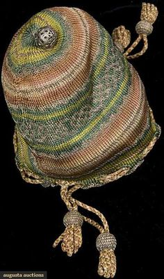 "SMALL DRAWSTRING KNIT PURSE, LATE 1500s Striped silk knit bands in light green, dark green, coral, ivory, metallic silver & gold, center w/ wide dark green band & gold inter-twined strands, pierced silver ball at purse bottom, double pink & cream silk drawstring cords at top, looped cords below gilt balls on drawstrings, 4.5"" x 3.5"""