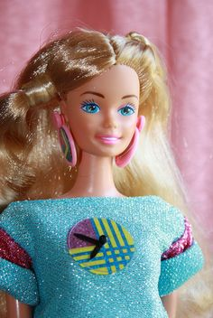 1987 Fun Time Barbie, named so because she came with a real watch for a little girl, mine came in a pink outfit but I think you had 3 colours to chose from, pink, blue or yellow, though all dolls were the same. Mine is named Melinda in Dolton.