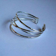 I love cuffs!  They fit so snuggly, and the freeform silver wire makes me feel all springy.  Well it is September.