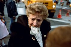 New Film Profiles NYC's Greatest Street Photographers | Untitled ($10 Bill in Mouth), NYC. 1992.  Jeff Mermelstein  | WIRED.com