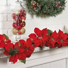 Poinsettia garland is pretty! I bet Magnolia & Poinsettia mixed would be pretty Outdoor Christmas Tree Decorations, Christmas Flowers, Christmas Centerpieces, Christmas Time, Christmas Ideas, Gold Christmas, Christmas 2016, Christmas Stuff, Christmas Wedding