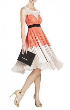 $178.00 Color-blocking and a classic A-line silhouette come together here for the must-have look of the season. Round neck. Sleeveless. A-line skirt.Allover sunburst pleating. Color-block detail.Contrast banded waist.Sateen: Polyester.Dry Clean.Imported.