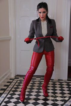 Strict mistress in red boots dominates