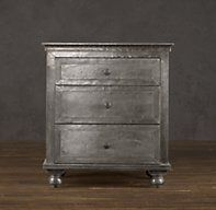 "Zinc closed nightstand: Our meticulously crafted dressers and nightstands offer the industrial appeal of zinc – omnipresent in les bars zincs of France. A patina that grows richer with time adds warmth to the brushed surface, hand-finished to rustic perfection. No two pieces are alike, making each item truly unique.  Dimensions 18""W x 18""D x 26""H 22""W x 19""D x 28""H 26""W x 19""D x 28""H"