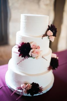 A boho maroon + blush wedding cake!  Love the simple white layers with bunches of flowers on each tier.  An elegant way to dress up your classy wedding cake --- and love the maroon flowers for a winter wedding! Photo taken at THE SPRINGS in McKinney, Stone Hall.  Follow this pin to our website for more information, or to book your free tour! Photographer:  Texas Sweet Photography #weddingcake #weddingcakeideas #winterwedding #winterweddingcake #maroonwedding #simpleweddingcake #weddingideas