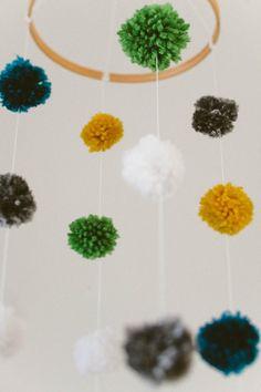 yarn pom-pom mobile. i can make that...