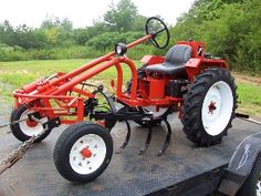 "Tuff-bilt Tractor System, $10k starting, 18hp, tread width adjustable from 36-46"", 3-pt hitch front and back."