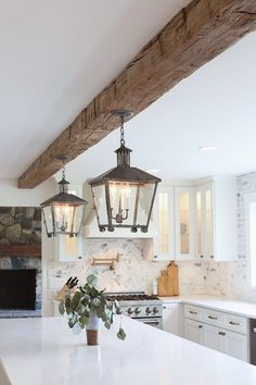 Gorgeous pendant lights and rustic beam in this farmhouse kitchen. all white kitchen with reclaimed wood beam from real antique wood - lindsay marcella design All White Kitchen, New Kitchen, Kitchen Decor, Kitchen Ideas, Long Kitchen, Design Kitchen, Kitchen Island, Küchen Design, House Design