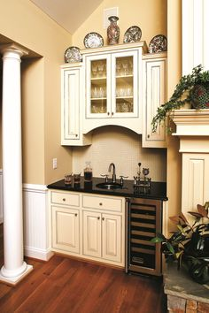 Instead of built-in shelving by the fireplace, this homeowner had a custom wet bar installed in the great room! www.dongardner.com - The Satchwell Plan 967 #House #Plan #Wetbar