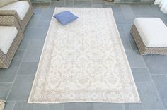 FREE GLOBAL SHIPPING!!!  A delightfully low pile rug with floral motif throughout, in soft colors of cream, and light brown with subtle notes of