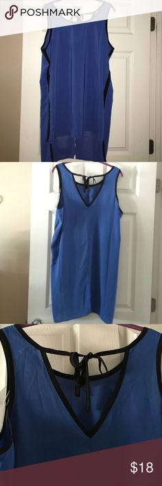Silky top Blue with black accent. High/low. Spense Tops