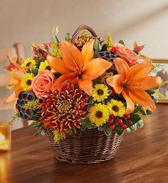 This Arrangement: A rustic basket filled with orange, yellow and bronze fall flowers. 800 Flowers, Fall Flowers, Wedding Flowers, Wedding Bouquets, Summer Flowers, Colorful Flowers, Basket Flower Arrangements, Fall Floral Arrangements, Basket Of Flowers