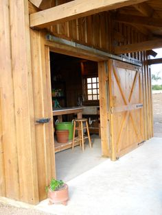 Large barn doors on an outdoor shed (right door slides over fixed ...
