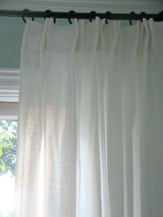 diy euro pleat...If I could afford, professionally sewn, european linen drapes, I would, but I can't ,so.....I reworked IKEA RITVA curtains. any curtains that have the hidden rod pockets in the header will work. Find the rod pocket part of the drape..