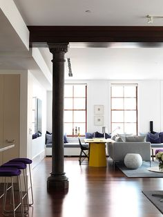 A Tribeca, New York loft by Melbourne-based interior design firm Nexus Designs. The interior was inspired by the owner's favourite picture of the NSW Blue Mountains and incorporated dusky blues and purples, wood and sunny yellow