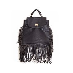 Faux leather Black gold fringe backpack book bag Open to offers! Gorgeous faux leather black fringe backpack with gold hardware. Brand new never used. Long hanging tassel fringe detail with handle on top that makes it easy to carry or hang up. Twist buckle closure. Straps are removable if desired. Multiple available. !!Please do not purchase this listing! Ask me to make you a separate one! Bags Backpacks