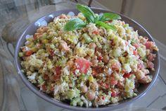 ~Quinoa Greek Salad~   -Quinoa  -Chick Peas  -Red Peppers  -Tomatoes  -Cucumbers  -Feta  -Corn    -Basil  -Parsley  -Green Onion  -Olives    -Dressing: Olive Oil, Fresh squeezed lemon, lemon zest, salt, pepper, oregano, dijon mustard.